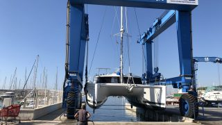 Dos Peregrinos gets lifted out for winter - Port Roda de Bara, Catalonia Spain