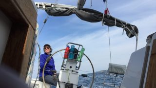 Karen helming our mono - life at 30 degrees