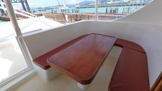 wood table on catamaran
